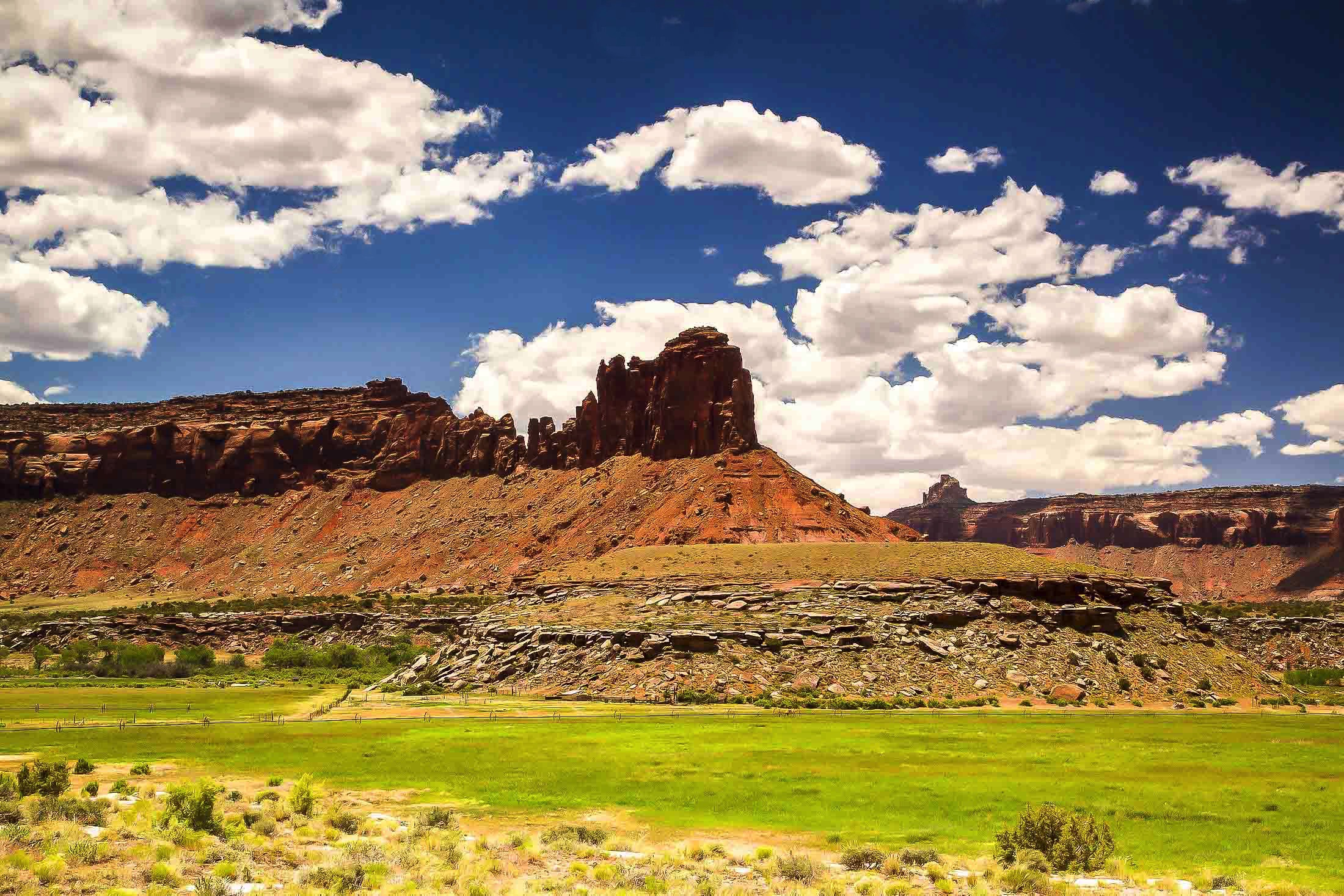 miles of canyons, , deep rich burnt umbers, wide ranging, open landscapes, billowing clouds, moab utah, panorama, photo